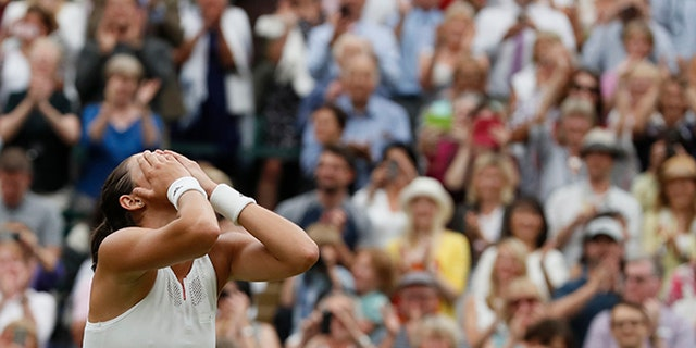 Spain's Garbine Muguruza celebrates after beating Venus Williams of the United States to win the Women's Singles final match on day twelve at the Wimbledon Tennis Championships in London Saturday, July 15, 2017.