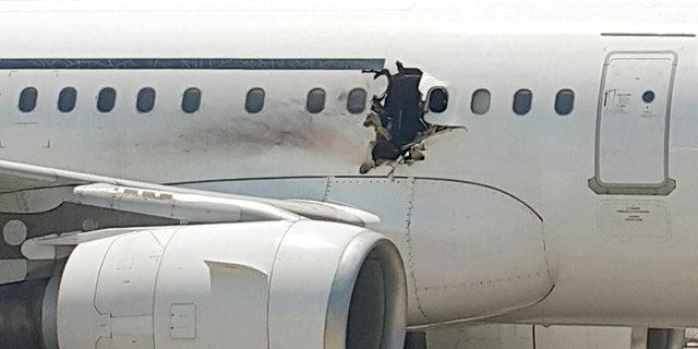 The damaged passenger jet after its emergency landing in Mogadishu.