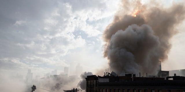Smoke rising from the fire and building collapse in March 2015.