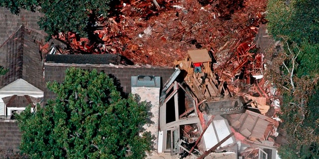 Crews demolish the former home of O.J. Simpson in July of 1998.