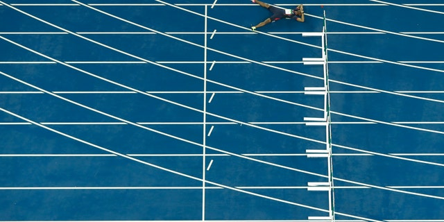 France's Wilhem Belocian lays on the track after his false start in a 110 meter hurdles heat during the athletics competitions of the 2016 Summer Olympics at the Olympic stadium in Rio de Janeiro, Brazil, Monday, Aug. 15, 2016. (AP Photo/Morry Gash)