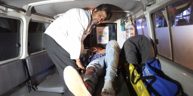 A wounded person treated in an ambulance.