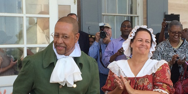 Craig Syphax and Donna Kunkel portray their ancestors at a June re-enactment of the 1821 wedding of slaves Charles Syphax and Maria Carter at Arlington House, the estate once owned by George Washington's adopted son, George Washington Parke Custis.