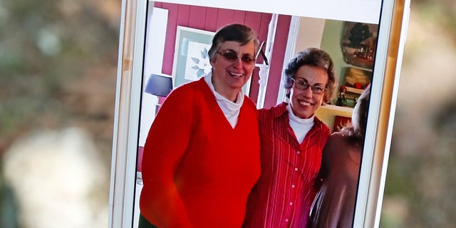 Jamie Sample shows a photo taken December 2015, showing Sisters Paula Merrill, left, and Margaret Held.