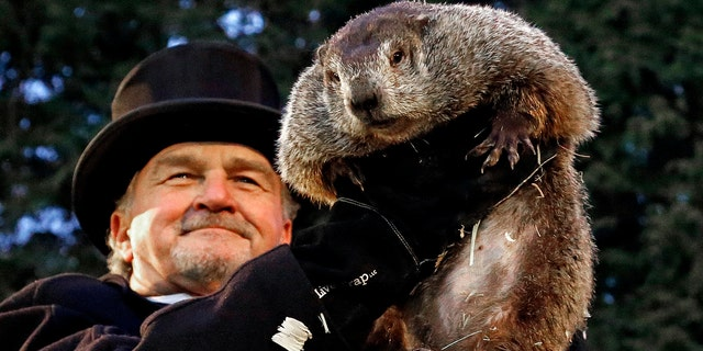 Groundhog Club handler John Griffiths holds Punxsutawney Phil, the weather prognosticating groundhog, during the 131st celebration of Groundhog Day on Gobbler's Knob in Punxsutawney, Pa. Thursday, Feb. 2, 2017. (Associated Press)