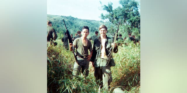 James McCloughan, right, with a platoon interpreter in Nui Yon Hill in Vietnam, in 1969.