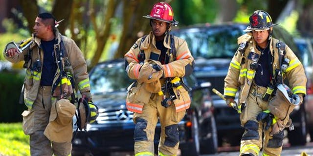 Houston firefighters at the scene.