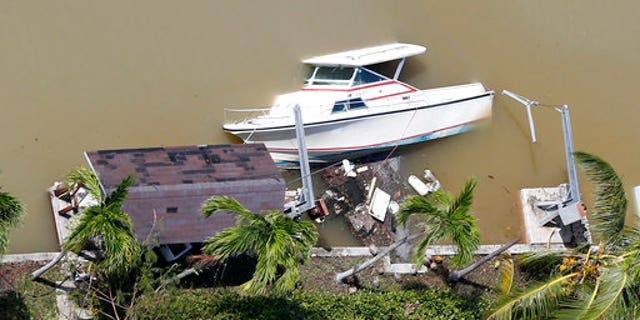 A boat is partially submerged in a canal in the wake of Hurricane Irma.