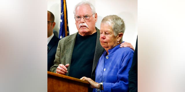 John Lyon hugs his wife, Mary, right, after a plea by Lloyd Lee Welch Jr., for the killings of their daughters Sheila and Katherine Lyon in 1975.