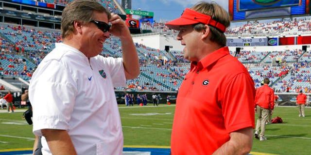 Florida head coach Jim McElwain, left, with Georgia head coach Kirby Smart on Saturday.