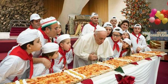 Pope Francis blowing out the candle at the Vatican.