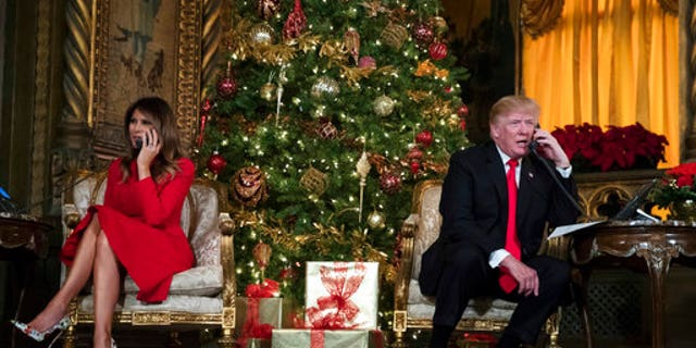 President Donald Trump and first lady Melania Trump spoke on the phone with children as they tracked Santa Claus' movements.