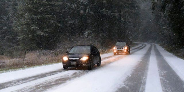 Snow on the road near Yelm, Wash., on Sunday.