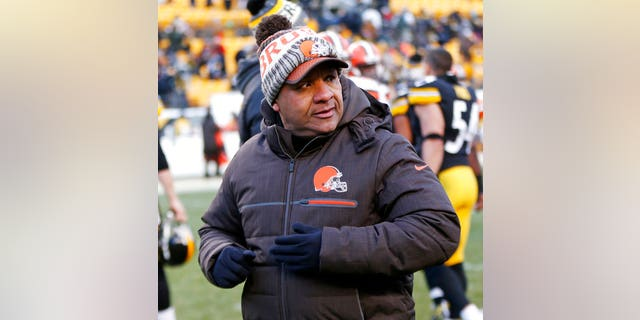 Cleveland Browns head coach Hue Jackson walking off the field after the game.