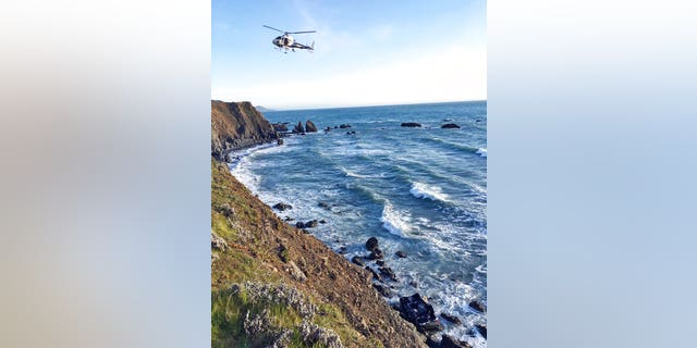 A helicopter hovers over the Northern California site where the Hart family's SUV was discovered Monday afternoon.