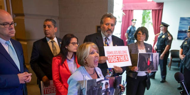 Rep. Michelle Lujan Grisham, center, and other Democratic lawmakers shouted at Trump.