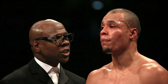 Chris Eubank, Sr., left, speaking to his son Chris Eubank, Jr. during a fight in February.