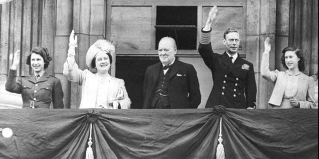 From l-r: Princess Elizabeth, Queen Elizabeth, Winston Churchill, as Britain Prime Minister, King George VI, and Princess Margaret of Great Britain wave to crowds from the balcony of Buckingham Palace during VE Day celebrations on May 8, 1945.