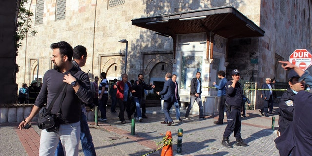 Security officials secure the area after an explosion outside the historical Ulu Cami in Bursa, Turkey, Wednesday, April 27, 2016. Turkish officials say a suicide attack has hit the northwestern city of Bursa, a popular tourist destination. A security official told The Associated Press the attack Wednesday was carried out by suicide bomber. (IHA agency via AP ) TURKEY OUT