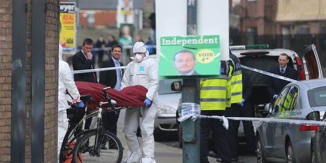 The body of Eddie Hutch is removed from a property in Dublin Tuesday.