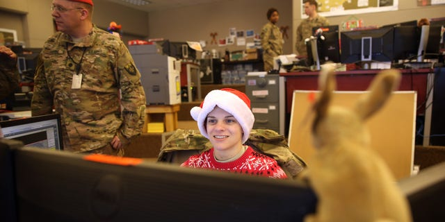 U.S. soldiers work in their office on Christmas day at Bagram Air Field, north of Kabul, Afghanistan, Friday, Dec. 25, 2015. (AP Photo/Massoud Hossaini)