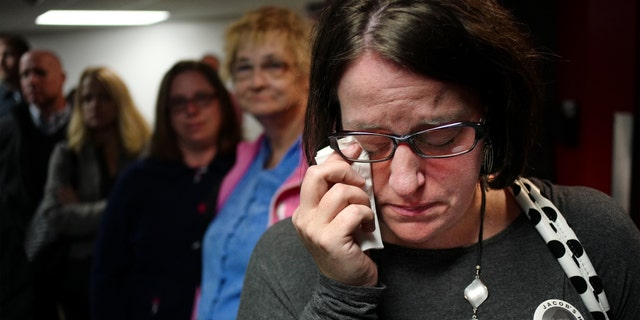 Leslie Bergwall weeps at the memorial service.