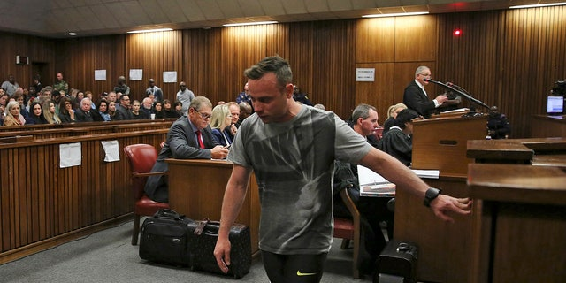 Oscar Pistorius, walks on his stumps during argument in mitigation of sentence by his defense attorney Barry Roux in the High Court in Pretoria, South Africa, Wednesday, June 15, 2016. An appeals court found Pistorius guilty of murder and not a lesser charge of culpable homicide for the shooting death of his girlfriend Reeva Steenkamp. (Siphiwe Sibeko, Pool Photo via AP)