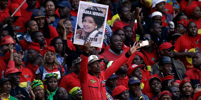 Tens of thousands of people sang, cheered and cried as the flag-draped casket of anti-apartheid activist Winnie Madikizela-Mandela was escorted from her official funeral on Saturday.