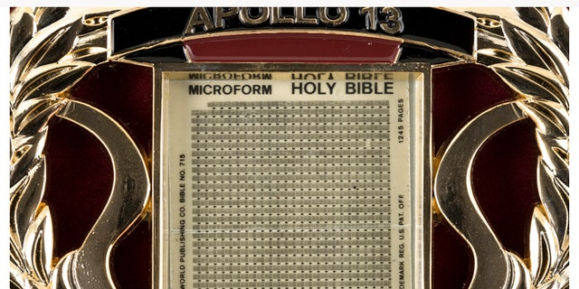A close up of the miniature microform that flew on the Apollo 13 mission (Nate D. Sanders Auctions)