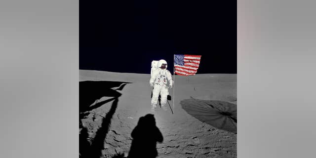File photo - Astronaut Edgar Mitchell, Apollo 14 lunar module pilot stands by the U.S. flag on the lunar surface during the early moments of the mission's first spacewalk. He was photographed by astronaut Alan Shepard, mission commander. (NASA)