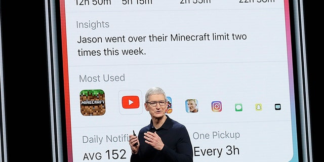 Apple CEO Tim Cook speaks in front of a Screen Time image during an announcement of new products at the Apple Worldwide Developers Conference Monday, June 4, 2018, in San Jose, Calif. (AP Photo/Marcio Jose Sanchez)