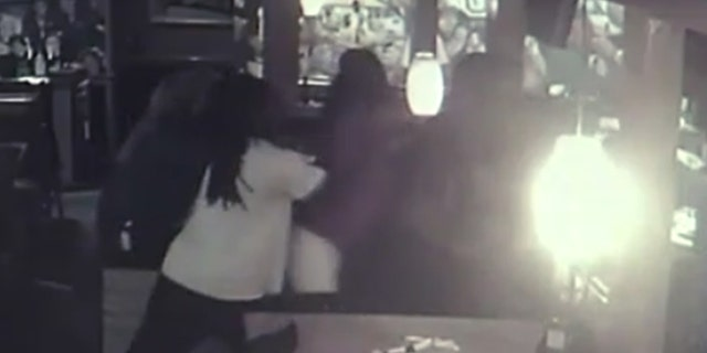 Customers tried to break up the fight Tuesday at an Applebee's location in McDonough, Ga.