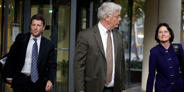 Nov. 13, 2013: Harold McIlhenny, center, an attorney representing Apple Computer in the Apple Samsung trial, exits a federal courthouse in San Jose, Calif.