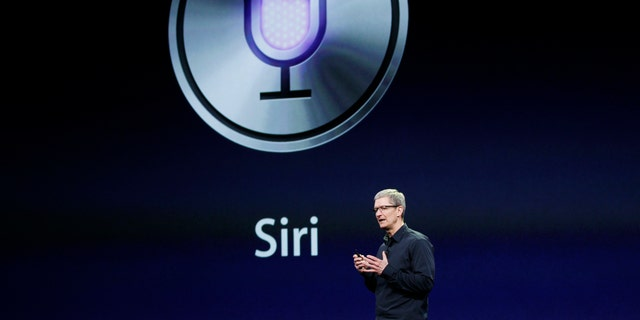 Apple CEO Tim Cook talks about Siri during an Apple event.