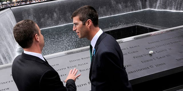 Architect Michael Arad (R), who designed the 9/11 Memorial, visits the North Pool of the 9/11 Memorial during ceremonies marking the 10th anniversary of the 9/11 attacks on the World Trade Center, in New York, September 11, 2011. (REUTERS/Justin Lane)