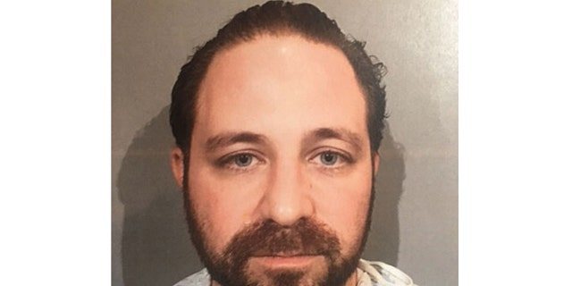 Mugshot for Aramazd Andressian, 35, charged in son's disappearance.