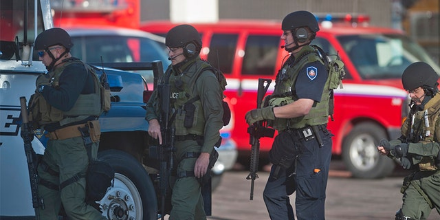Dec. 13, 2013: Armed law enforcement officers gather at Arapahoe High School, after a student opened fire in the school in Centennial, Colorado.
