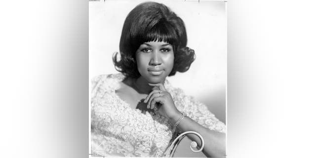 Aretha Franklin poses for a photo in 1960.