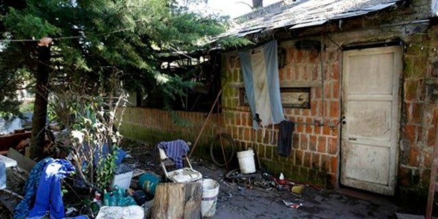 Sept. 5, 2015: An Argentine flag hangs from the home where Eduardo Oviedo is accused of keeping his wife and autistic son locked up in Mar del Plata, Argentina.
