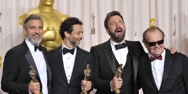 "George Clooney, from left, Grant Heslov, Ben Affleck pose with their award for best picture for ""Argo"" pose with presenter Jack Nicholson, right, during the Oscars at the Dolby Theatre on Sunday Feb. 24, 2013, in Los Angeles. (Photo by John Shearer/Invision/AP)"