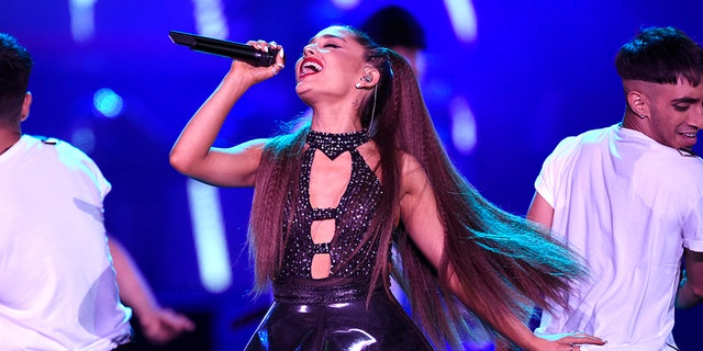 FILE - In this June 2, 2018 file photo, Ariana Grande performs at Wango Tango in Los Angeles. Grande will perform at the funeral for Aretha Franklin on Friday, Aug. 31. (Photo by Chris Pizzello/Invision/AP, File)