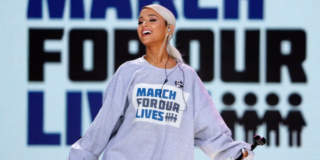 """Singer Ariana Grande performs the song """"Be Alright"""" as students and gun control advocates hold the """"March for Our Lives"""" event demanding gun control after recent school shootings at a rally in Washington, U.S., March 24, 2018."""