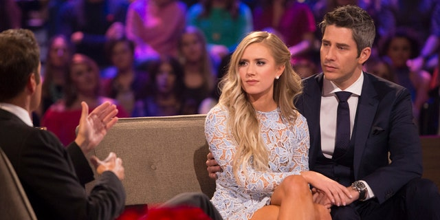 """Arie Luyendyk Jr. and his fiancee Lauren Burnham appear on """"The Bachelor"""" finale."""