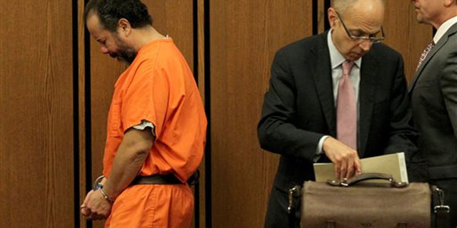 Ariel Castro walks past his attorneys in Cuyahoga County Common Pleas Court, in Cleveland, Ohio, Wednesday, June 26, 2013.