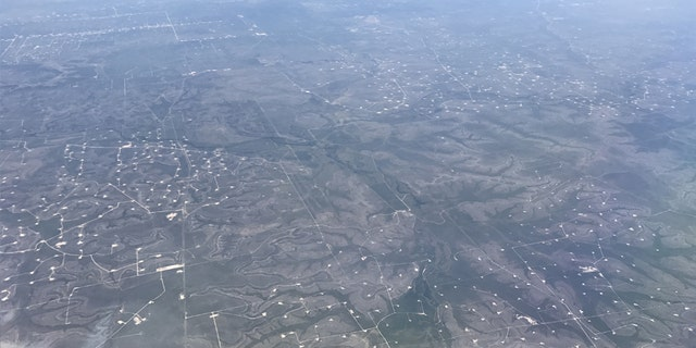 Aerial view of oil wells seen near Midland, Texas, U.S., May 2, 2017. Picture taken May 2, 2017. REUTERS/Ernest Scheyder - RC1366764970