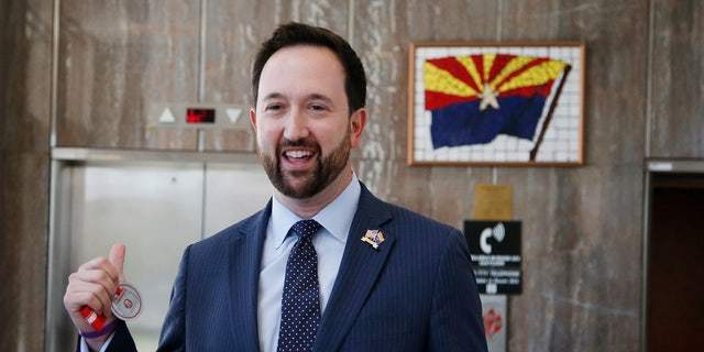 Aug. 14, 2014: Republican Arizona congressional candidate and current state Rep. Adam Kwasman, R-Oro Valley, arrives for a news conference.