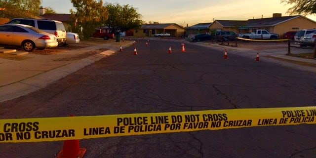 Crime scene tape outside the home where a 19-year-old pregnant woman was shot dead.