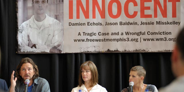"Singer Eddie Vedder, left, Lori Davis, center, wife of Damien Echols, and singer Natalie Maines, right, participate in a news conference Saturday, Aug. 28, 2010, before the ""Voices for Justice"" concert in Little Rock, Ark. Supporters of the ""West Memphis Three"" argue there were two sets of victims from the May 5, 1993 crime: the three murdered 8-year-olds and Damien Echols, Jason Baldwin and Jessie Misskelley, the then-teenagers who defenders claim were wrongly convicted in the deaths."