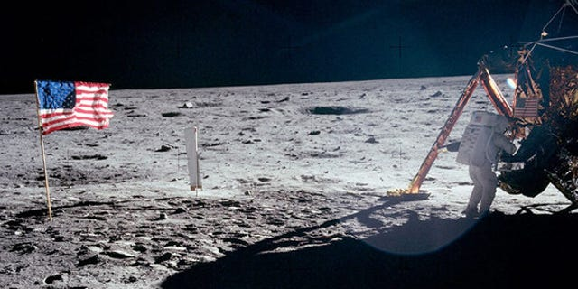 "The only full-body photo of Neil Armstrong on the moon shows him working at the Apollo 11 lunar module ""Eagle."""