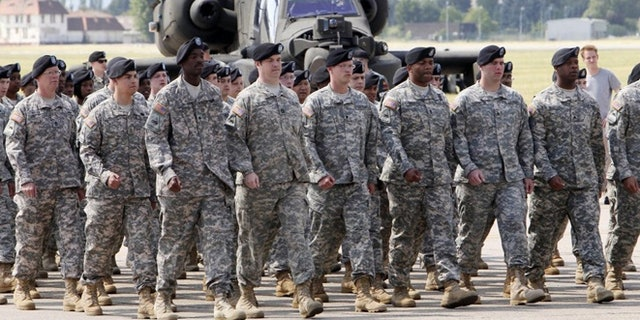The black beret, seen above, was shelved in 2011 as the official headgear for the Army Combat Uniform. Now some soldiers want the right to roll up their sleeves, particularly during summer months in warm climates. (AP)